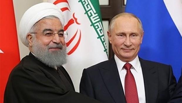 Ruhani: Şam'ın onayı olmadan yabancı güçlerin Suriye'de varlığına karşıyız!