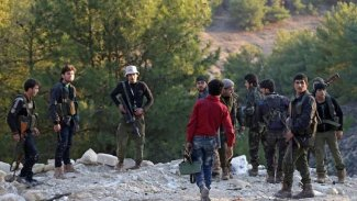 Grûpên çekdar hewl didin ciwanên Efrînê bibin şerê Lîbyayê
