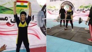 İran'da altın madalya kazandı: Podyumda Kürdistan bayrağını kaldırdı