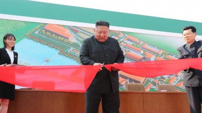 Öldüğü iddia edilen Kim Jong-un fabrika açılışına katıldı