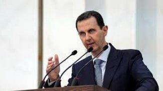 Esad kürsüde fenalaştı,konuşmasını yarıda kesti