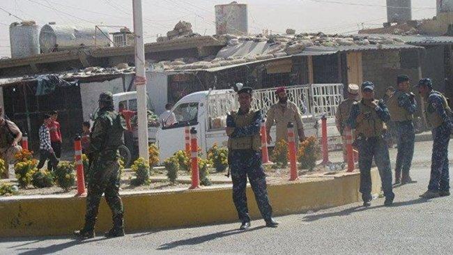 Şengal'de silahlı grupların bayrakları indirildi