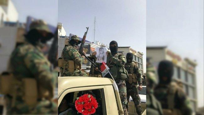 ABD'yi tehdit ettiler: Şii milislerden Bağdat'ta gövde gösterisi